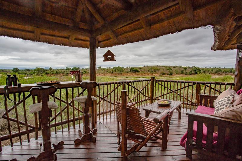 The large deck overlooking Crocodile river and Kruger Park. The best view in the whole park - Majuli River Lodge in Marloth Park beside Kruger - Marloth Park - rentals