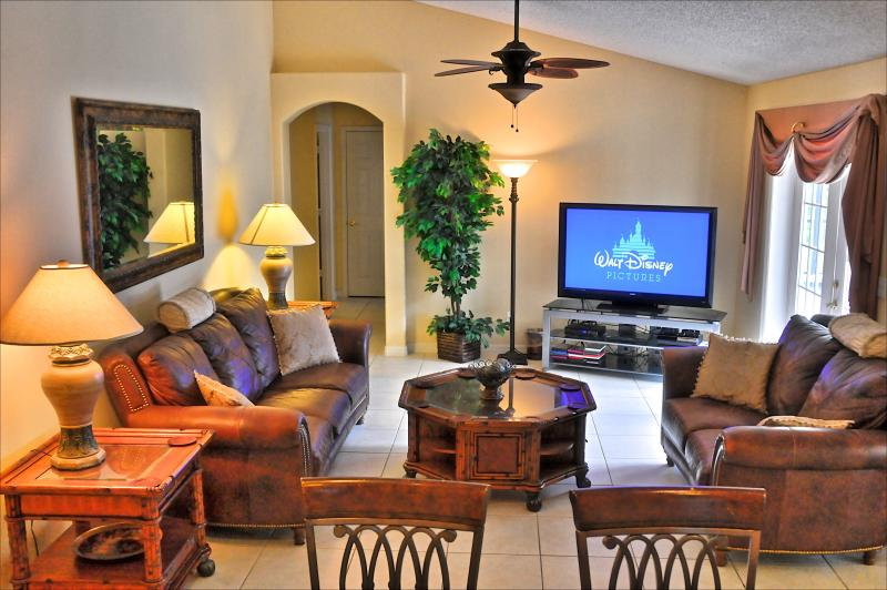 "The family room with luxurious all leather furnishings, 55"" HDTV, PS4 - Prestige 5 Bed  4 Bath Disney Vacation Villa - Clermont - rentals"