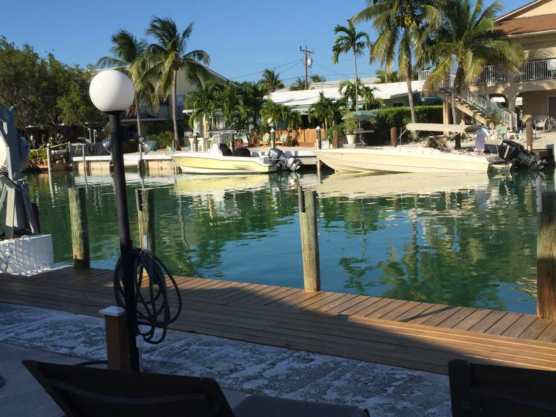 Sitting on the patio overlooking the dock and canal - Key Colony Beach Griffins' Getaway - Key Colony Beach - rentals