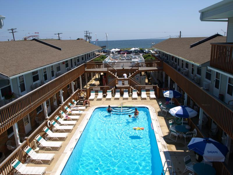 Our heated pool is the center for family-friendly fun. - Heated Pool, Beach Just Across the Street - Seaside Park - rentals