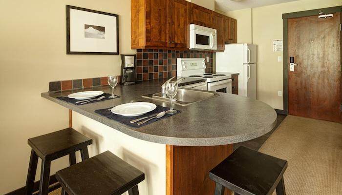 The kitchen area comes fully-equipped and features a breakfast bar - Panorama Upper Village Ski Tip & Tamarack Studio Condo - Panorama - rentals