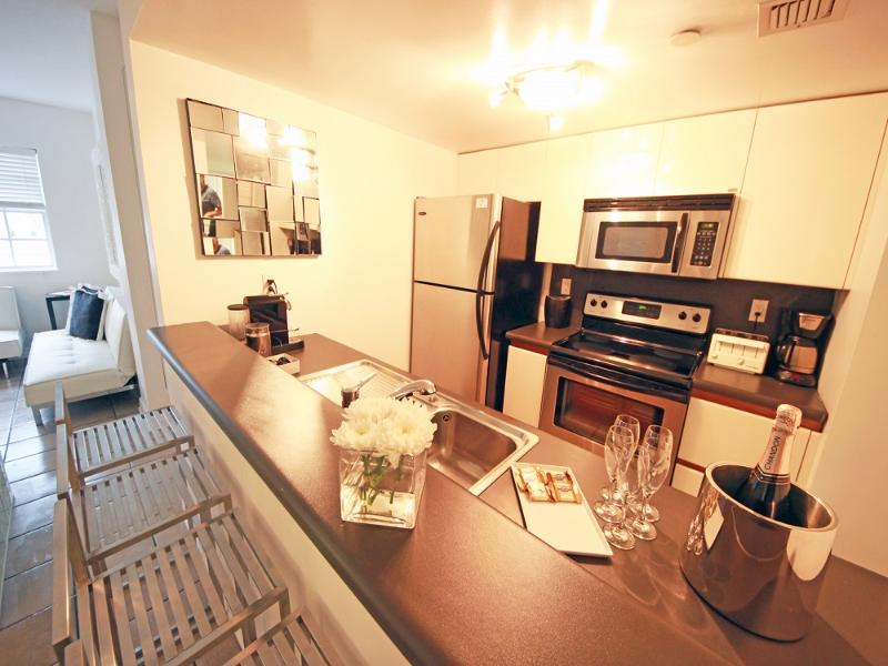 Spacious Full Size Kitchen with Eat in Bar - 4 Room Cosmopolitan Deluxe Suite on Ocean Drive - Miami Beach - rentals