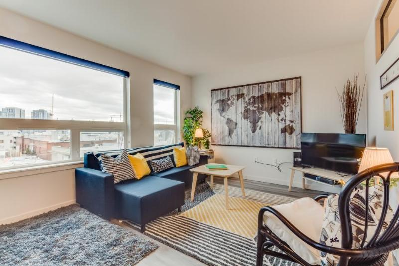 Dog-friendly Capitol Hill condo with city views, a shared roof deck & gym! - Image 1 - Seattle - rentals