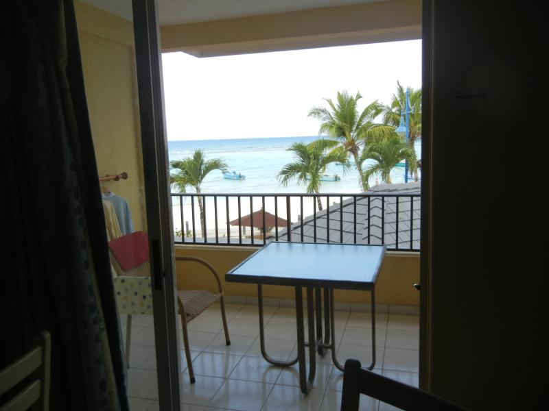 wake up in the morning, open the curtain, and this is what you see - Studio apt. with ocean view (high demand location) - Christ Church - rentals