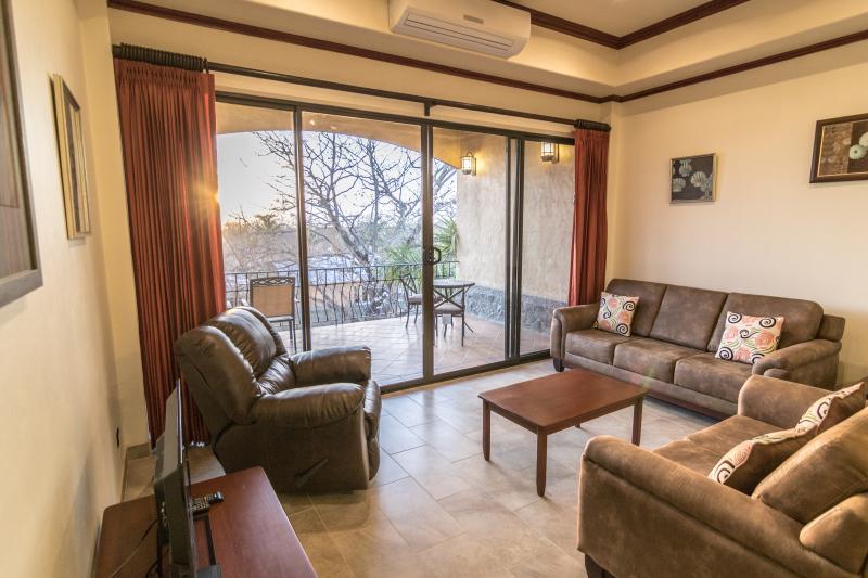 Condo #6 living room - New 2BR Playa Junquillal Condo at Tierra Pacifica - Playa Junquillal - rentals