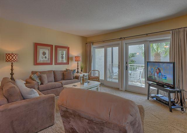 Living Room with Flat Screen TV & Sleep Sofa - 2 Bedroom Oceanside Villa with Partial Ocean Views - Hilton Head - rentals