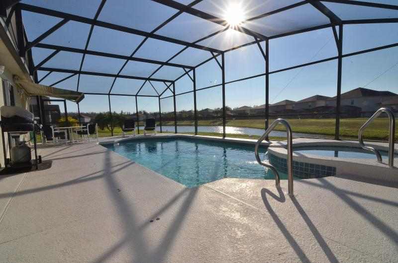 Pool area - Pet friendly 3 bedroom pool home with lake views - Intercession City - rentals