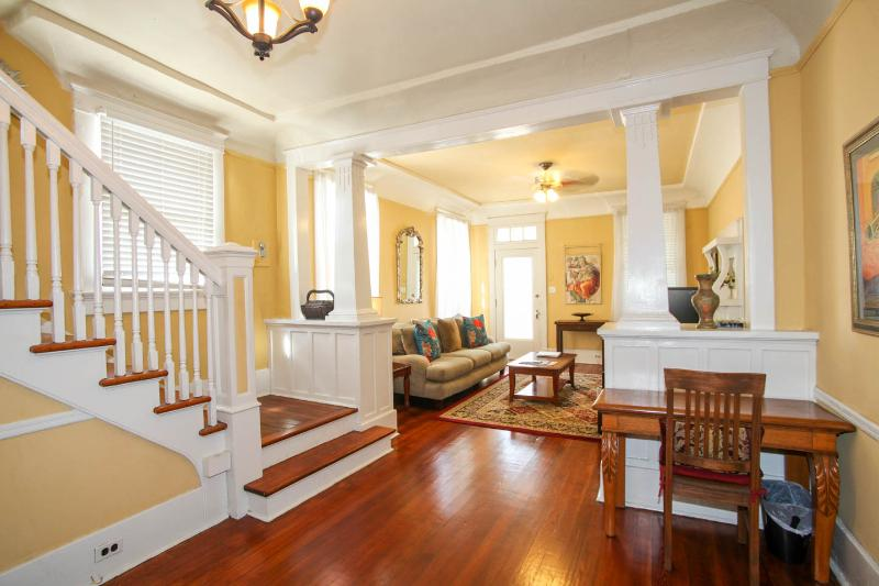 Large, Open Living Area w/ Original Fireplace, Opens to Front Porch. Central Stairway to 2nd Floor. - BEST CENTRAL LOCATION_Large3BRCondo_GardenDistrict - New Orleans - rentals