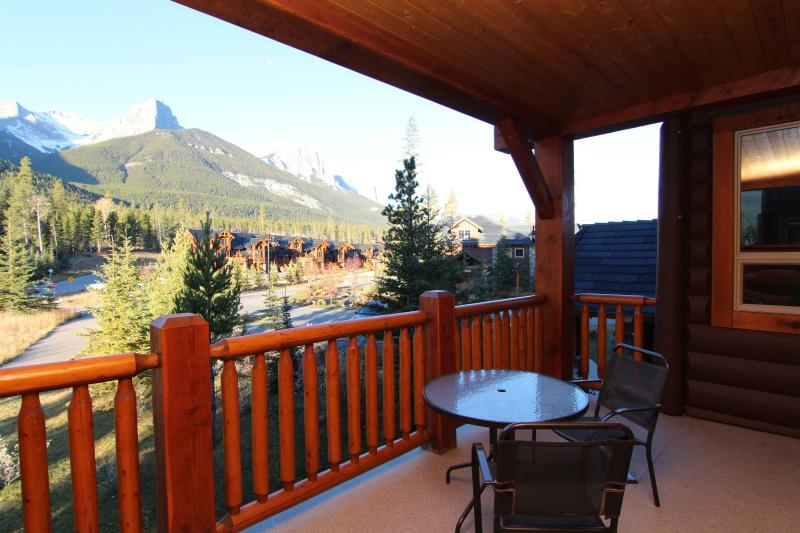 A private balcony allows you to soak in the breathtaking view of the Three Sisters - Canmore Three Sisters Mountain Homes Lovely 2 Bedroom Condo - Canmore - rentals
