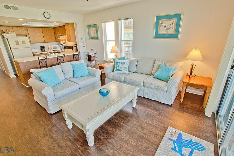 Living Room  - Surf Condos 328 - Miller Time - Stunning Decor with Ocean View and pool access - Surf City - rentals