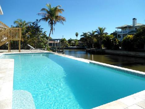 33 foot infinity pool with massage jets & underwater lights for night-time dips. - Island Villa   33' Infinity Pool, Dolphin Visits - Fort Myers Beach - rentals
