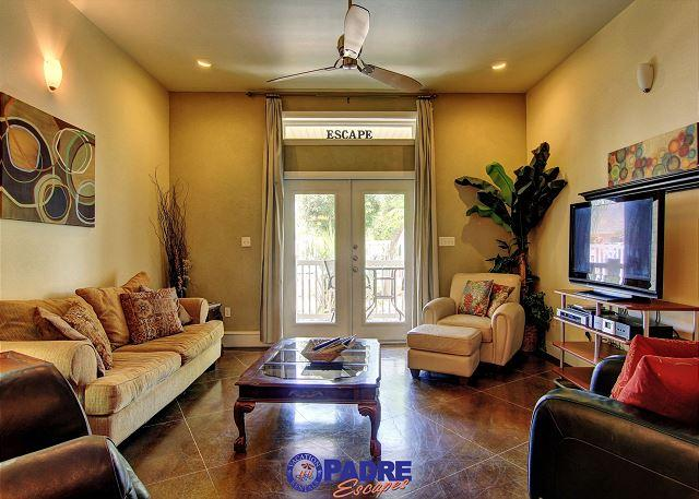 Luxurious living area with a pool view - Beautiful Poolside 2/2.5 Townhouse with Luxurious Upgrades! - Corpus Christi - rentals