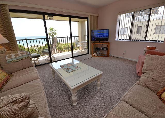 Living room with Gulf front balcony and flat screen TV - Lands End 10-405 - Gulf Front Top Floor Corner Condo in Paradise! Free WiFi! - Treasure Island - rentals
