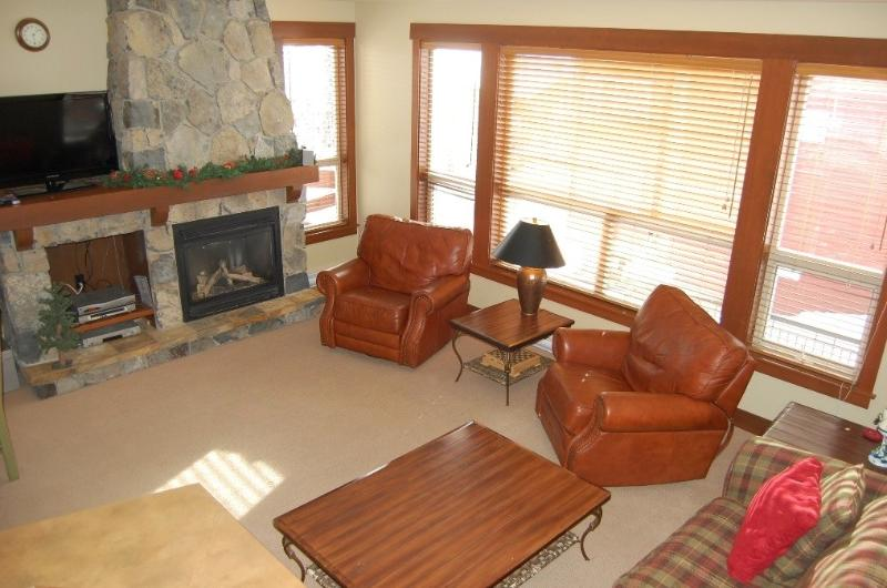 Relax by the fireplace in this charming living area - Big White Stonebridge Lodge 1 Bedroom Executive Condo with Hot Tub - Big White - rentals