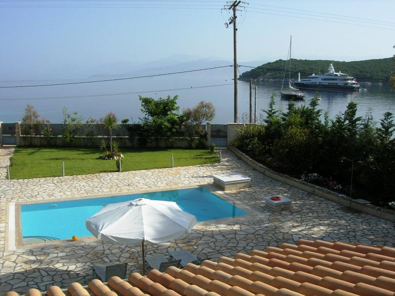 Avlaki beachfront villa with pool in Kassiopi - Image 1 - Avlaki - rentals