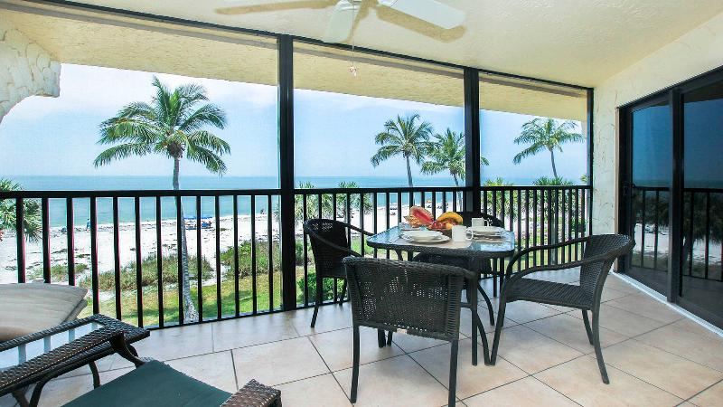 Beautiful lanai seating and beach views.  We are as close to the beach as you can get on Sanibel. - Direct Gulf Front Completely Remodeled - E36 - Sanibel Island - rentals