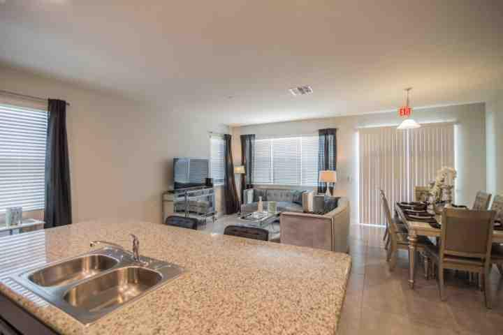 Open Floor Plan - Living Area, Dining Area & Kitchen w/Private Patio Access - 5137 Compass Bay - Kissimmee - rentals