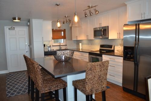 Luxurious kitchen with stainless steel appliances and granite table and chairs. - Beautiful Ocean Front Condo! No-Drive Beach! - Daytona Beach Shores - rentals