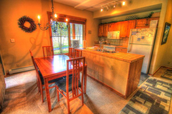 Dining/Kitchen - There is plenty of room for 6 at this dining room table that can be expanded (shown) or contracted to fit your needs.  The kitchen is VERY well stocked and large. - 1856 The Seasons - Lakeside Village - Keystone - rentals