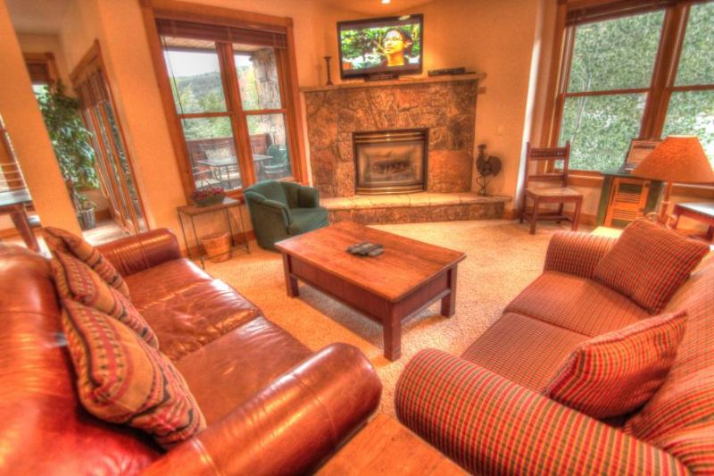 Living Room - The large and spacious living room is the perfect place to gather after a long day on the slopes. - 201 Mill Creek - River Run - Keystone - rentals