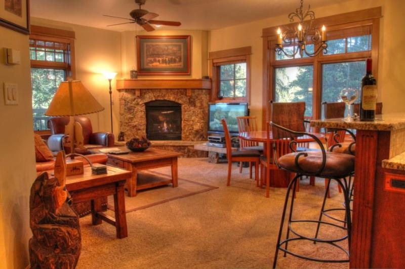 Living Room - Relax by the natural stone fireplace with views on two sides of the snake river. - 3003 Lone Eagle - River Run - Keystone - rentals