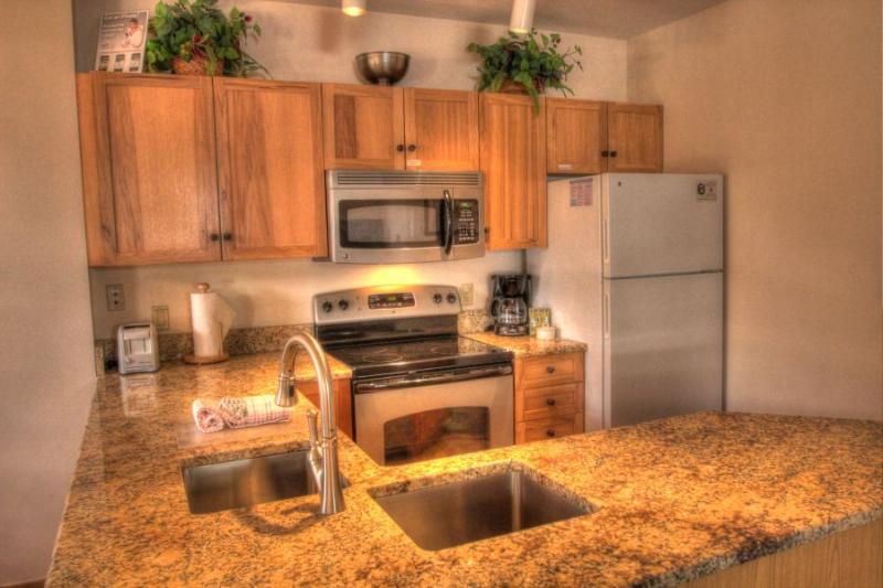 Kitchen - Kitchen features granite countertops and stainless steel appliances. - 8452 Dakota Lodge - River Run - Keystone - rentals