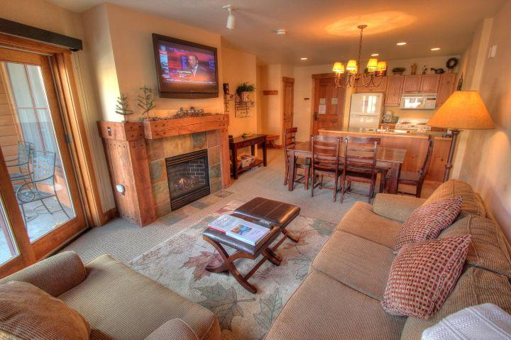 Living Area - Nice new furniture with that rustic look and a queen sleeper sofa.  The TV is huge and has 8 HD channels. - 8854 The Springs - River Run - Keystone - rentals