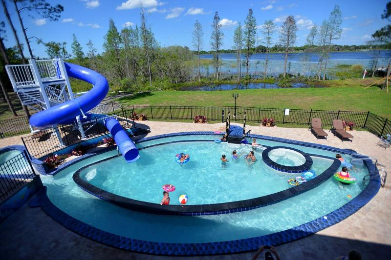 """Go Fish"" Pool, Lazy River, Giant Waterslide, Kiddy Slide, Hot Tub - The Great Escape Lakeside, Sleeps Up to 45 - Clermont - rentals"