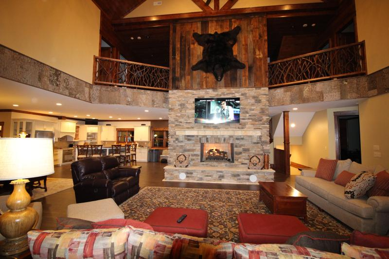 "Huge great room with comfortable seating for 10. Convenient gas log fireplace, 75"" Sony 4K DirecTV. - Luxury Mountain Lodge to make Awesome Memories - Sapphire - rentals"
