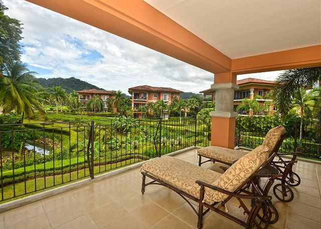 Terrace with lots of privacy! - Style & Grace await in this Ocean View Condo at Los Sueños! Great Location! - Herradura - rentals