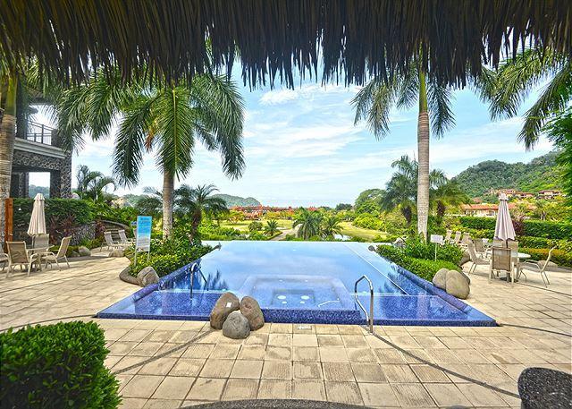 Pool area at the Vista Bahia common area at Los Sueños! - Spectacular Sunset & Ocean View Condo at Los Sueños! - Herradura - rentals