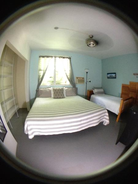 Master bedroom comes with a king size bed, twin size bed, full size dresser, and closet> - Ocean Avenue Guest House 2 Bedroom Villa - Isabela - rentals