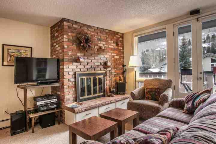 "Living room with wood burning fireplace, 38"" flat screen TV/DVD and mountain views. - Condo located between Vail Village & Lionshead, Walk To Gondola, On In-Town Bus Route, Mtn View! - Vail - rentals"