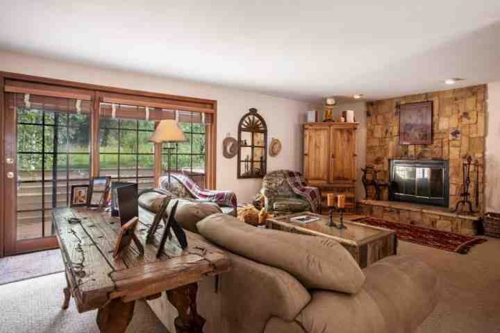 "Spacious living room with 37"" flat screen TV, wood burning fireplace, 1/2 bath and deck access to hot tub. - East Vail Home, Close Bus Stop, Easy Access to Vail, Private Hot Tub, Great for - Vail - rentals"