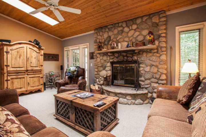 Enjoy relaxing by the fireplace after a day on the slopes in this cozy living room. - Family Friendly Townhome, Great Value, Steps to Bus, Minutes to Slopes! - Vail - rentals