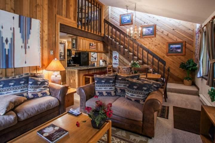 View of living room, dining area and kitchen.  Stairs access a private seating area for 2 and the master bedroom. - East Vail Condo, Short Walk to Bus Stop, Sleeps 8, Hot Tub, Seasonal Pool - Vail - rentals