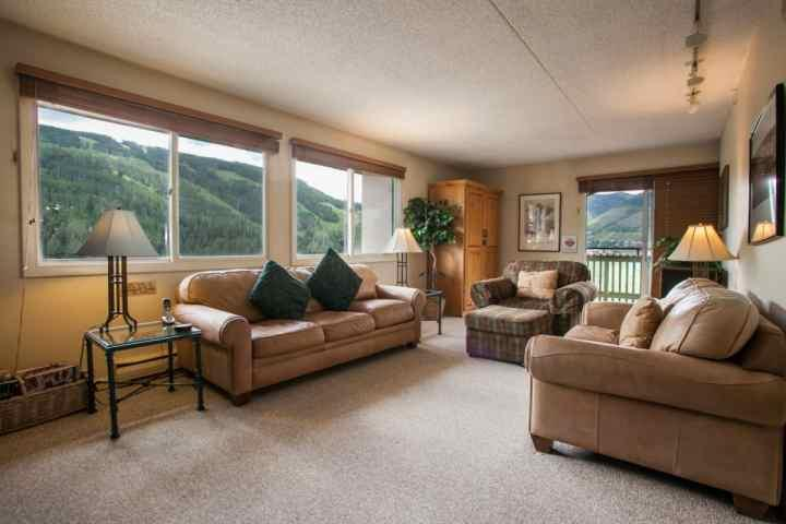 Spacious living area, queen sofa sleeper and views of Vail Mountain from 7th floor balcony. - 7th Floor Condo, Balcony Views of Vail Mountain, Great Value, Centrally located to Vail & Lionshead - Vail - rentals