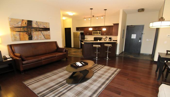 The condo features sleek, modern furnishings and a large living space - Canmore Grande Rockies Resort Fantastic 1 Bedroom Condo - Canmore - rentals