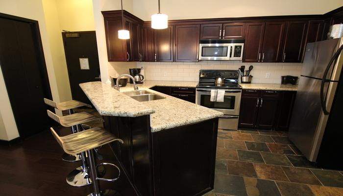 Modern, sleek kitchen with stainless steel appliances - Canmore Grande Rockies Resort 2 Bedroom Condo (King & Queen) - Canmore - rentals