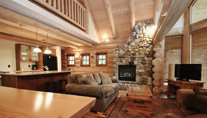 This fabulous home boasts a beautiful stone fireplace - Fernie Snow Creek Cabins 3 Bedroom Log Cabin - Fernie - rentals