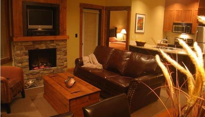 Lounge in front of the beautiful, rock fireplace. - Fernie Timberline Lodge 1 Bedroom Platinum Condo - Fernie - rentals