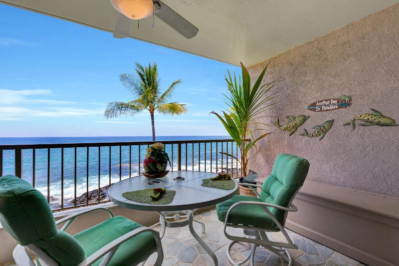 An inviting lanai is for you to enjoy - Kona coffee in the a.m., - meals and sunsets in the p.m. . - Kona Reef Oceanfront condo! NO Traveler Fees! - Kailua-Kona - rentals