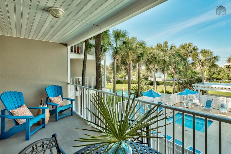 Enjoy a glass of wine on your patio with views of the pool. - Amazing condo at Gulf Place Caribbean, community pools, short walk to beach - Blu Caribbean - Santa Rosa Beach - rentals