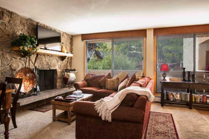 Open living area features wood burning fireplace and mountain views. - Scorpio Condo, No Car Necessary, Located on Free In-Town Bus Route, Heart of Vail & Lionshead! - Vail - rentals