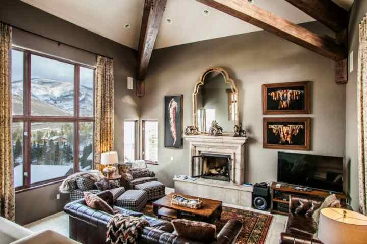 "Main level living room with gas fire place, 60"" flat screen TV, DVD and spectacular mountain views. - Single Family Home, Private Hot Tub, Great for Large Groups, Family Friendly - Vail - rentals"