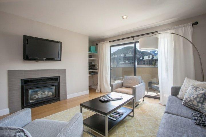 Modern living room featuring flat screen TV, DVD, deck access and views of Beaver Creek Mountain. - Seasons at Avon Condo, Walk to Riverfront Gondola, Easy Bus location into Vail, Family Friendly! - Avon - rentals