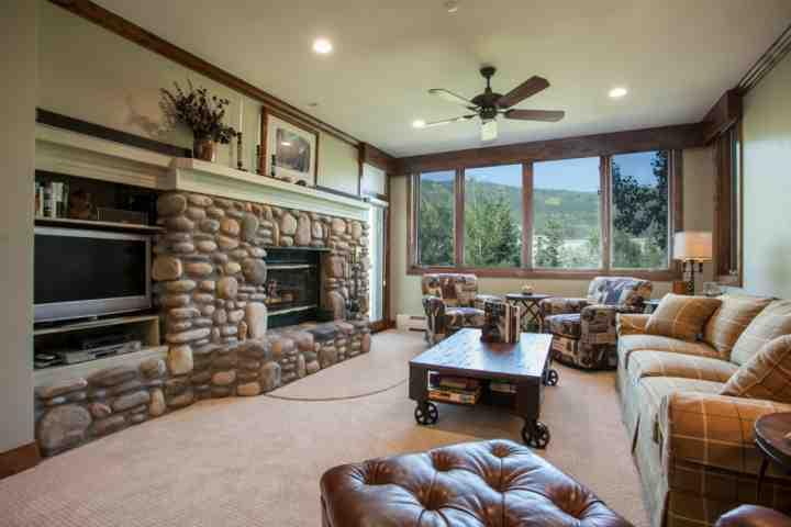 Highlands Lodge residence located on the second floor.  Living room with king sofa sleeper, wood burning fireplace and flat screen TV. - Beaver Creek, Highlands Lodge Condo, Ski In/Ski Out, Year Round Pool & Hot Tubs, No Car Needed! - Beaver Creek - rentals