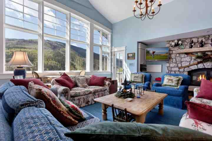 Comfortable living room with plenty of seating, game table for 2, flat screen tv and gas fireplace, deck access with fire pit and views of Vail Mtn. - Sandstone Single Family Home, Perfect for Large Groups, Private Hot Tub, Lg - Vail - rentals