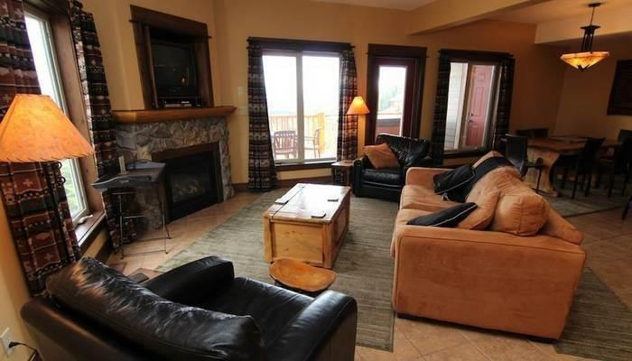 This spacious living area features a cozy fireplace, a flat screen TV and a DVD player - Kimberley Northstar Mountain Village 2 Bedroom Townhome - Kimberley - rentals
