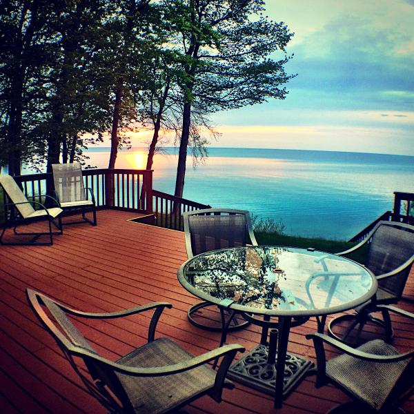 See the sunset from the windows or Deck.  Plenty of seating and a gas grill. - Peaceful Sunset Cottage on Lakefront - Sodus - rentals
